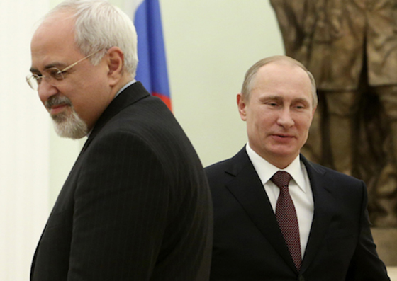 Russian President Vladimir Putin, right, passes by Iranian Foreign Minister Mohammad Javad Zarif during their meeting in the Kremlin in Moscow, Russia, Thursday, Jan. 16, 2014. Putin creditedTehranfor the success of international talks on the Iranian nuclear program andcalledfor boosting Russian-Iranian trade. (AP Photo/Sergei Karpukhin, Pool)
